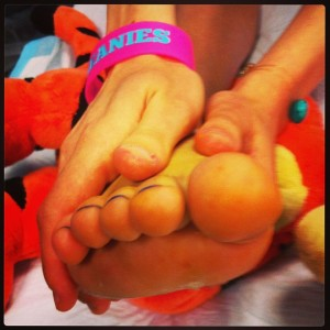 Tigger offering support holding up injured foot and loving hands holding foot before surgery