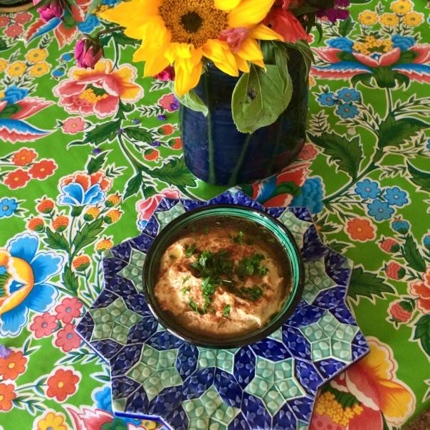 Hummus served right, in a beautiful Moroccan bowl, with Henry's Olive Oil, paprika and chopped parsley from my garden. The plate underneath the bowl was made by my brother Paul Barchilon