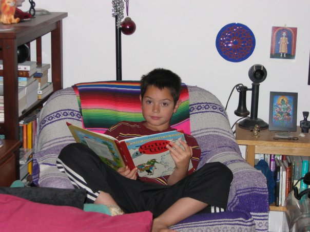 Ethan reading TinTin at Uncle Paul's House a long time ago