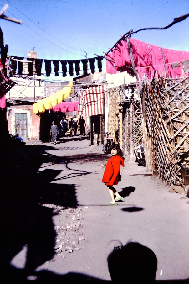Nicole, in her red riding hood cape, age seven in Morocco