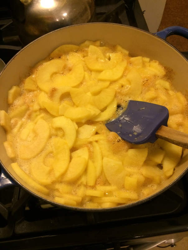 Peeled and Sliced apples cooking in applejuice.