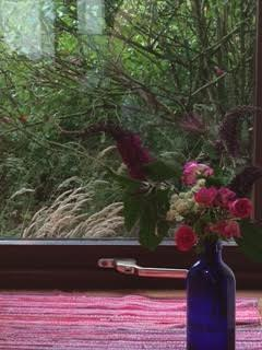My Breakfast nook view, with flowers from outside my cabin