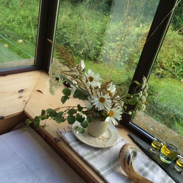 Erev Yom Kippur at my cabin in Ireland, getting ready for a day alone of fasting and prayers, by setting the space with beauty and white for purity of intention and space
